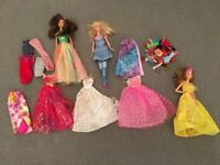 Barbie dolls and assorted clothing, virtually unused. 3 dolls and multiple outfits and accessories.