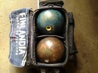 bowling balls and bag on wheels