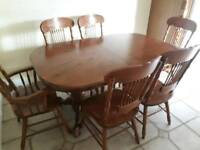 Antique pine extending dining table and 6 chairs