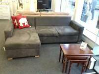 Grey corner sofabed wih storage at BHF Glasgow