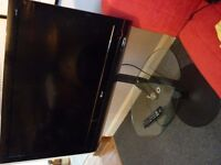 LG Tv hd ready, freesat, freeview, + cantilever black and glass stand