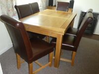 Solid oak extending table and 6 dining chairs