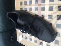 Adidas black Stan Smith trainers