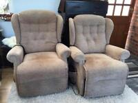 His and hers reclining electric armchairs