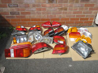 Job lot of various headlights and tail lights Ford Vauxhall Audi VW FIAT Rover