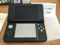 New Nintendo 3DS + 5 Games