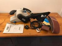 MacAllister Belt sander with six sanding belts.