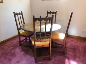 ercol dining table and 4 chairs in excellent condition