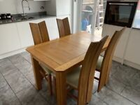 Solid Oak Dining Table and 4 solid oak chairs
