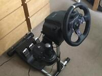 wheel stand pro *(stand only)* and 3 Xbox one games