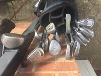Set of golf clubs, driver and bag