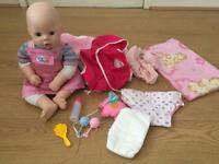 Interactive baby doll with clothes and accessories