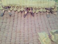 Hand knitted baby's pram or crib blanket 20inches by 23 knitted in soft Pom Pom wool