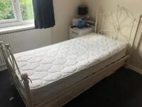 Cream iron bed frame with hideaway bed and 2 single mattresses (used v. good condition)