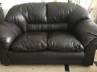 2 seater leather sofa in brown like new drill has its labels attached. Smoke free home