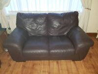 Three and two seater brown leather sofas