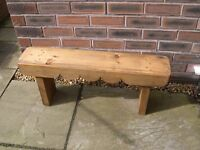 A wooden garden bench with triple scallop trim.