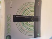 Xbox 360 elite, includes 2 controllers, headset and five games. Good condition