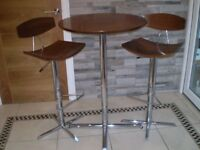 Quality wooden bar table and 2 chairs. Hardly used, slight mark on table top. Can deliver locally.
