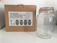 Four large preserving jars