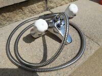 Bath mixet taps and hose with spray head