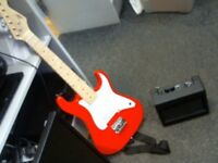 KIDS 1/2 SIZE CBSKY ELECTRIC GUITAR WITH AMP, BAG AND STRAP.