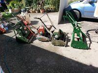 4 vintage Lawn mowers.