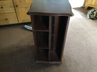 Cd/DVD cabinet, rotating by Charles Sheraton in mahogany colour.