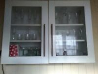 White kitchen cabinet with glass doors