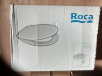 New unused quality toilet seat by 'Roca' easy fit with chrome hinges £25