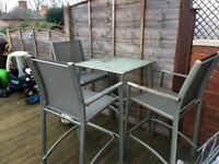 Outside table and three chairs