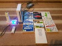 Nintendo Wii console with one controller & games including wii sports and wii sports resort