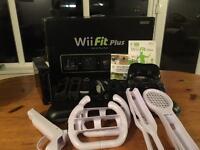 Nintendo Wii Fit Plus + extras.