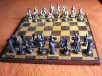 LARGE ROMAN/GREEK METAL CHESS SET ON CARVED BOARD/BOX