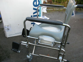 Drive medical shower wheelchair with foot-rests.