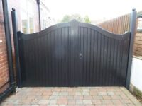 Pair of 10 ft. wide wooden driveway gates with steel posts