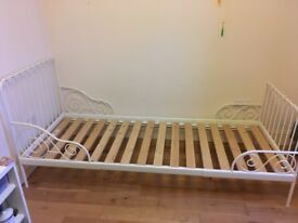 White single bed frame with cot sides, can be shortened.