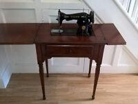 Vintage sewing machine in hideaway table