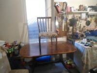 Oval extending dining table and 7 chairs