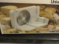 Electric food slicer with variable cutting thickness. Never been used