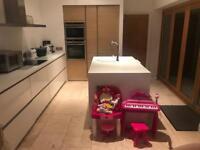 Corian kitchen, oak cabinets. Intoto West Bridgford