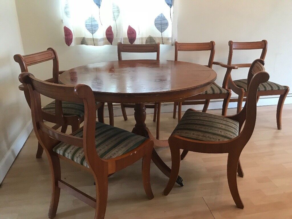 round extending dining table with 6 chairs  in crawley
