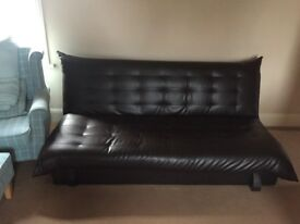 Brown leather sofa bed with storage and