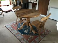 Quality round table and 2 chairs in solid wood.