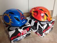 Two children's cycle helmets excellent condition with boxes