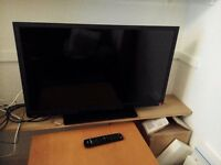 Toshiba 32-inch 32W1333DB HD Ready LED TV with a remote control