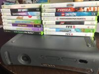 Xbox 360 with one chargeable controller and 14 games