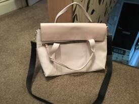 Large pale pink faux leather bag.