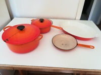 Job lot of Le Cruestet cast iron casseroles, dishes and pan in volcanic orange