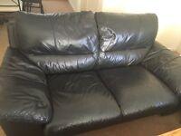 2x 2 seater black leather sofa,